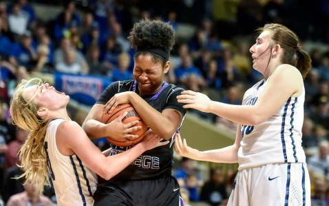 Dakota Wesleyan's Rylie Osthus (10) gets hit in the face fighting for a loose ball with Goshen College's Lynnia Noel (23) as Dakota Wesleyan's Kelsey Bertram (30) was also involved in the play during the third round of the NAIA Division II women's national tournament on Saturday at the Tyson Events Center in Sioux City, Iowa. (Matt Gade/Republic)