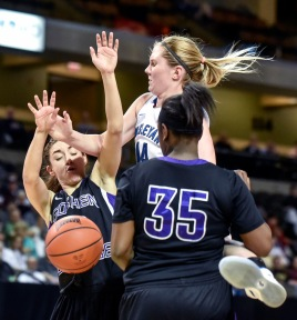 Dakota Wesleyan's Erica Herrold (14) looses the ball colliding into Goshen College's Haley Archibeque (10) and Goshen College's Tyra Carver (35) during the third round of the NAIA Division II women's national tournament on Saturday at the Tyson Events Center in Sioux City, Iowa. (Matt Gade/Republic)