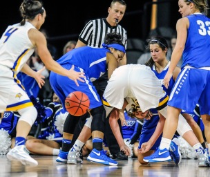 South Dakota State University's Clarissa Ober (21) makes a pass between her legs to South Dakota State University's Gabrielle Boever (4) during a game in the first round of the Summit League conference tournament on Saturday at the Denny Sanford Premier Center in Sioux Falls. (Matt Gade/Republic)