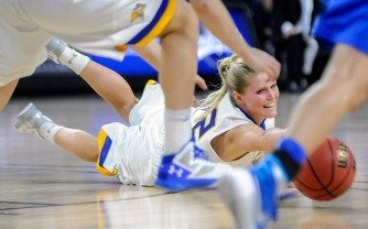 South Dakota State University's Chloe Cornemann (22) tries to chase down a loose ball during a game in the first round of the Summit League conference tournament on Saturday at the Denny Sanford Premier Center in Sioux Falls. (Matt Gade/Republic)