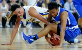 South Dakota State University's Kerri Young (10) and IPFW's De'Jour Young (13) fight for a loose ball on the ground during a game in the first round of the Summit League conference tournament on Saturday at the Denny Sanford Premier Center in Sioux Falls. (Matt Gade/Republic)