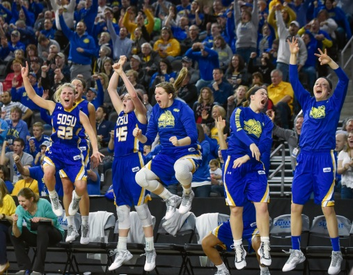 The Jackrabbits bench celebrate a 3-point basket by South Dakota State University's Madison Guebert (11) during a game in the Summit League conference championship on Tuesday at the Denny Sanford Premier Center in Sioux Falls. (Matt Gade/Republic)