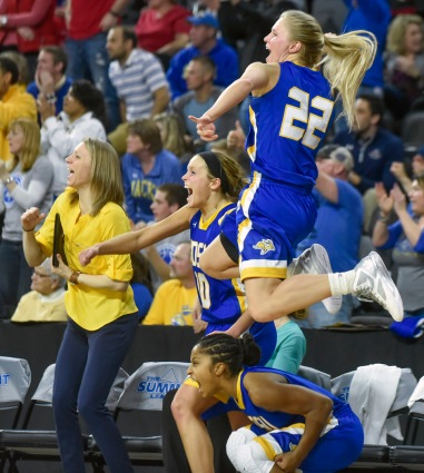 South Dakota State University's Chloe Cornemann (22), top, South Dakota State University's Alexis Alexander (1), bottom, and South Dakota State University's Kerri Young (10) celebrate a defensive stand by the Jackrabbits during a game in the Summit League conference championship against the University of South Dakota on Tuesday at the Denny Sanford Premier Center in Sioux Falls. (Matt Gade/Republic)
