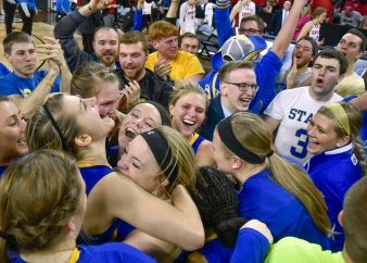 South Dakota State University's Macy Miller (12), left, and the rest of the Jackrabbits celebrate their win over the University of South Dakota Coyotes with the student body in the Summit League conference championship on Tuesday at the Denny Sanford Premier Center in Sioux Falls. (Matt Gade/Republic)