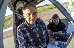 John O'Connell goes over his checklist inside the cockpit of his plane while Rodney Bahm watches prior to heading out to a field on Thursday, October 8, 2015 in Letcher. (Matt Gade/Republic)