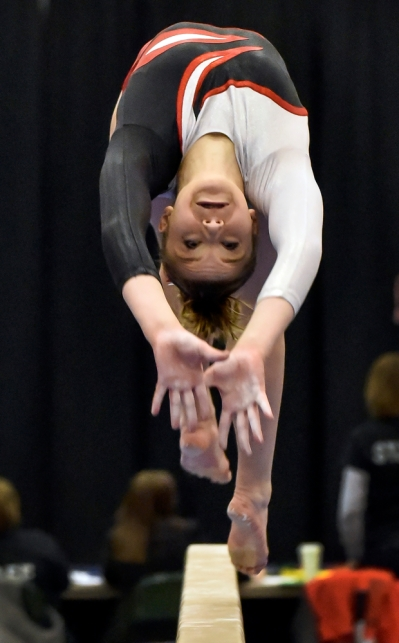 Wagner/Bon Homme's Emily Duffek does a backflip on the beam during the state gymnastics meet on Friday at Swiftel Center in Brookings. (Matt Gade/Republic)