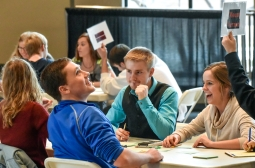 Mount Vernon's (from left) Emily Wieczorek, Kyle Koch, Joe Johnson and Ashley Glanzer celebrate a correct answer while competing in the Custer Battlefield Highway academic festival quiz bowl on Wednesday afternoon in the Sherman Center on Dakota Wesleyan University's campus. (Matt Gade/Republic)