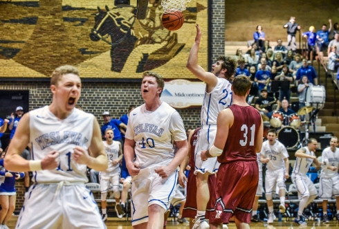 Dakota Wesleyan's Jason Spicer (40) along with Dakota Wesleyan's Tate Martin (11) and the Tiger bench celebrate Spicer's basket and foul on his rebound put back of Martin's shot attempt during a game against Hastings on Saturday at the Corn Palace in Mitchell. (Matt Gade/Republic)