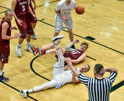 Dakota Wesleyan's Jade Miller (12) reacts to being called for the charge on Hastings' Drew Callaghan (33) during a game on Saturday at the Corn Palace in Mitchell. (Matt Gade/Republic)