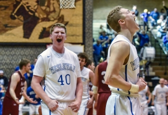 Dakota Wesleyan's Jason Spicer (40) along with Dakota Wesleyan's Tate Martin (11) celebrate Spicer's basket and foul on his rebound put back of Martin's shot attempt during a game against Hastings on Saturday at the Corn Palace in Mitchell. (Matt Gade/Republic)