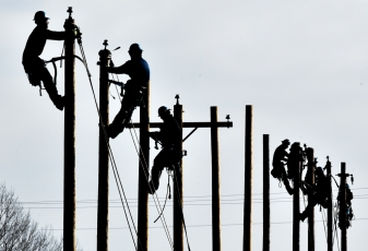 Students at Mitchell Technical Institute practice on the power poles on Tuesday morning along the northeast side of campus just south of Interstate 90. (Matt Gade/Republic)