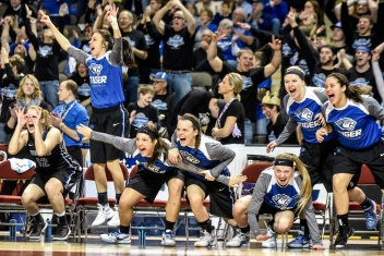The Tigers bench celebrates a 3-point basket by Dakota Wesleyan's Ashley Bray (20) during the second round of the NAIA Division II women's national tournament on Friday morning at the Tyson Events Center in Sioux City, Iowa. (Matt Gade/Republic)