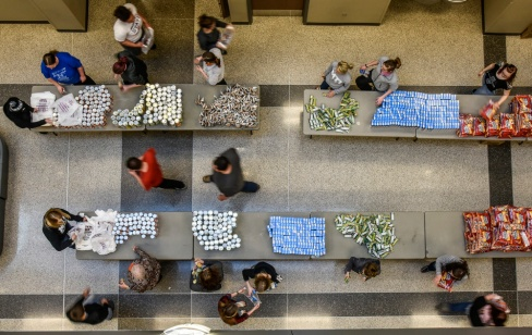 Over 50 students and faculty volunteer to help put together snack packs on Monday morning in the Campus Center at Mitchell Technical Institute. MTI students held a fundraising effort last week for the Weekend Snack Pack program. Over $3300 were raised. (Matt Gade/Republic)