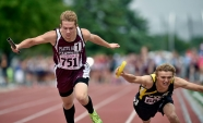 Platte-Geddes' Alex Gerlach, left, and James Valley Christian's Jayden Waldner reach out at the finish line running the anchor legs of the 3200 meter relay during the first day of the Class B state track and field championships on Friday, May 27 at Howard Wood Field in Sioux Falls.