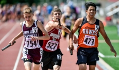 Corsica-Stickney's Hunter Johnson, center, stretches out with the baton between Platte-Geddes' Zach Pettit, left, and Canistota's Mandre Adams while running the anchor legs of the sprint medley during the first day of the Class B state track and field championships on Friday, May 27 at Howard Wood Field in Sioux Falls.
