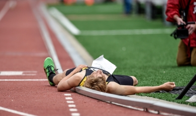 James Valley Christian's Jayden Waldner lays on the ground after stumbling and reaching out at the finish line while still able to hold off Platte-Geddes' Alex Gerlach, not pictured, to win the 3200 meter relay on the first day of the Class B state track and field championships on Friday, May 27 at Howard Wood Field in Sioux Falls.