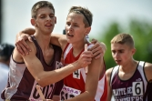 Freeman Academy's Thaniel Schroeder, left, and Gregory's Aaron Voigt walk off the track together after running the 3200 meter during the first day of the Class B state track and field championships on Friday, May 27 at Howard Wood Field in Sioux Falls.