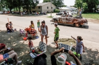 Kids get sprayed by the hose as the Corn Palace Hillbillies make their way down N. Vyborny Street during the 68th Annual Czech Days parade on Friday, June 17 in Tabor.