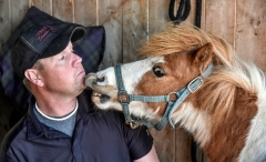 Niblet gets in the face of Chris Richards after tending to his hooves back in April at Cedar Ridge Equestrian Center north of Renner. Richards is a Farrier based out of Hurley serving clients in a 50 mile radius. (Date published: 6-10-2016)