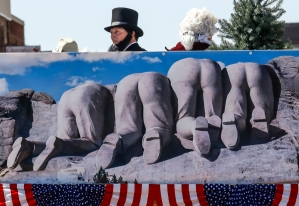 'Abe Lincoln' takes a peak at the crowd while the Mount Rushmore float takes part in the Corn Palace Stampede Rodeo Parade on Saturday, July 16 down Main Street in Mitchell.