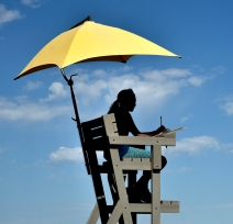 Ashley Reiners keeps score under the shade of an umbrella for the singles competition on Wednesday, July 13 during the first day of the South Dakota State Trap Shoot at the trap shooting range near the Davison County Fairgrounds on the west end of Mitchell.