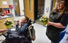 Shelly Randall, left, has a laugh after smelling the flowers that were brought by Renee' Polreis of Nepstad's Flowers & Gifts as part of Teleflora's 16th Annual Make Someone Smile Week on Wednesday, July 20 at LifeQuest in Mitchell. Polreis delivered 144 flowers on Wednesday.