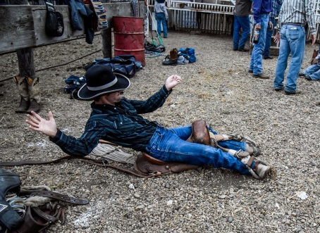 Zane Smith, of Broken Bow, Nebr., warms up on his saddle before the saddle bronc competition during the Wagner Labor Day Rodeo on Sunday in Wagner. (Matt Gade/Republic)