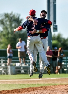 The Alexandria Angels' Pierce Smith, back, and Tyson Gau (5) leap into the air and hug after the final out to defeat the Garretson Blue Jays 7-1 in the Class B state amateur championship game on Sunday at Cadwell Park in Mitchell.