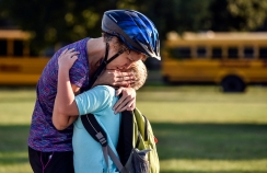 Becky Todd hugs her son Josiah Todd (8) before he heads to class on the first day of school. Josiah is starting third grade at Gertie Belle Rogers while his sister Lily (10), not pictured, is starting fifth-grade.
