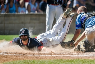 Alexandria Angels' Peyton Smith (1) dives into home to beat the tag attempt of Garretson Blue Jays' Brady Bonte during the Class B state amateur championship game on Sunday at Cadwell Park in Mitchell.