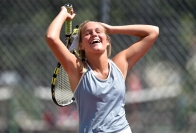 Mitchell's Avery Larson reacts after missing a shot during no. 2 singles action against Rapid City Central in the first match of a Triangular on Tuesday at Hitchcock Park in Mitchell.