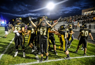 The Mitchell High School sideline celebrates a Spencer Neugebauer touchdown during a game against Yankton on Friday, Sept. 2 at Joe Quintal Field in Mitchell.