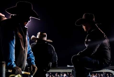 Spectators hang out along the chutes as the team roping competition goes on during the Wagner Labor Day Rodeo on Sunday, Sept. 4 in Wagner.