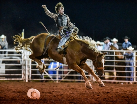 Kyle Hapney, of Harrold, loses his hat while competing in the saddle bronc during the Wagner Labor Day Rodeo on Sunday, Sept. 4 at the Wagner Rodeo Grounds.