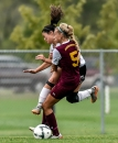 Mitchell High's Kyah Escobin (23) collides into Harrisburg's Alicia Aseltine (5) going for the ball during the second half of a game on Thursday, Sept. 22 at the Pepsi-Cola Soccer Complex.