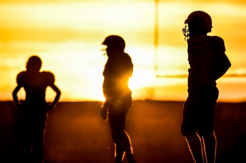 The Lyman Raiders wait for the Philip Scotties to come out of their huddle as the sunsets on Friday, Sept. 30 during a game in Presho.