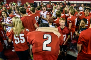 Gregory's Robert Vomacka (2) receives a hug after the Gorillas win over the Webster Area Bearcats for the Class 9AA state championship game on Thursday at the DakotaDome in Vermillion. (Matt Gade/Republic)