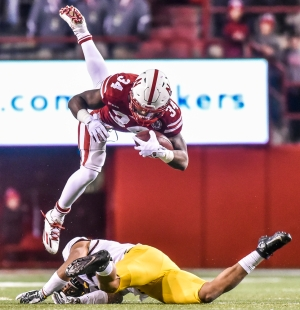 Nebraska Cornhuskers running back Terrell Newby (34) is knocked off his feet by Minnesota Golden Gophers defensive back Antoine Winfield Jr. (11) during a game on Saturday, Nov. 12 at Memorial Stadium in Lincoln, Nebr. (Matt Gade / Republic)