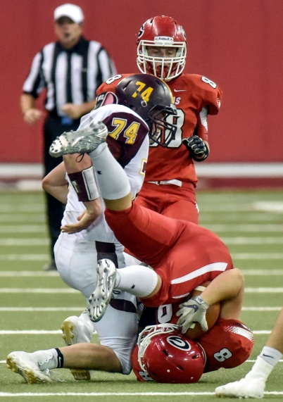 Webster Area's Colton Koslowski (74) upends Gregory's Jon Bakke (8) during the Class 9AA state championship game on Thursday at the DakotaDome in Vermillion. (Matt Gade/Republic)