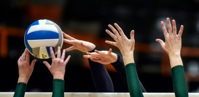 Sanborn Central/Woonsocket's Myah Selland, center, blocks a shot at the net during a match against Harding County during the Class B state tournament on Friday at the Huron Arena.