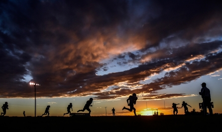 Colome's Will Cahoy, fourth from right, carries the ball as the sun sets in the first quarter of Colome's class 9B quarter-final game against Hamlin on Monday, Oct. 31 in Colome.