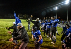 The Mount Vernon/Plankinton Titans sideline celebrates as the measurement comes up short for the Bon Homme Cavaliers causing a turnover on downs and allowing the Titans to run out the clock to win the game in the first round of the state playoffs on Tuesday, Oct. 25 in Mount Vernon.