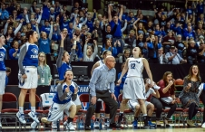 Dakota Wesleyan Head Coach Jason Christensen and the Tiger bench and fans celebrate a basket late during the first round of the NAIA Division II women's national tournament against Haskell Indian Nation University on Wednesday morning at the Tyson Events Center in Sioux City, Iowa. (Matt Gade/Republic)
