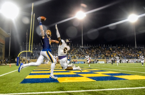 South Dakota State University wide receiver Connor Landberg (18) makes a one-handed touchdown grab over the arm of Western Illinois defensive back Xavier Rowe (6) in the first half of the Jackrabbits game against the Leathernecks in a Missouri Valley Conference game on Saturday at Dana J. Dykhouse Stadium in Brookings. (Matt Gade / Republic)