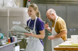 Sierra Messman and Ed Radack joke around while cleaning up in the kitchen on Friday, Jan. 13.