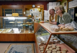 Ed and Carol Radack watch from behind the counter as they watch the people outside of the bakery on Wednesday morning.