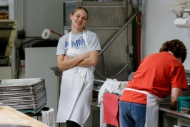 Sierra Messman has a laugh with Liza Plihal while cleaning the pans and trays after making the pastries on Friday, Jan 6. Sierra works part time in the mornings and is a senior at Bon Homme High School while Liza is the only other full time employee at the bakery beside Ed and Carol.
