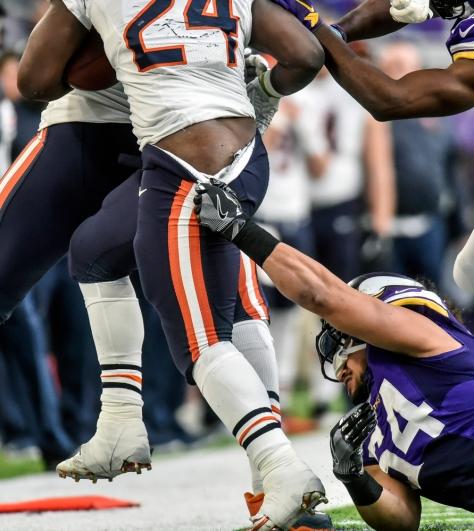 Minnesota Vikings linebacker Eric Kendricks (54) tries to bring down Chicago Bears runningback Jordan Howard (24) while grabbing onto his pants as Howard runs out of bounds during the final regular season game on Sunday at U.S. Bank Stadium in Minneapolis.