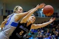Dakota State's Kennedy Wagner (2) stretches out for a rebound as Dakota Wesleyan's Rylie Osthus (10) reaches for the ball during a game on Wednesday night at the Corn Palace in Mitchell.