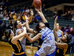 Dakota Wesleyan's Chesney Nagel (32) and Ashley Bray, second from left, vie for a rebound with a trio of College of Saint Mary defenders including Peyton Hagen (3) and Paige Muhammad (4) during a game on Friday night at the Corn Palace.